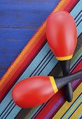 picture of maracas  - Happy Cinco de Mayo background with colorful maracas on Mexican theme dark blue distressed table with copy space - JPG