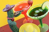 pic of mexican fiesta  - Happy Cinco de Mayo colorful party theme with bright color margarita drinks on red wood table and yellow background - JPG