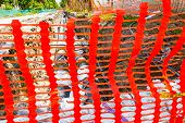 stock photo of safety barrier  - Construction site is protected by orange fence for safety - JPG