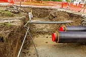 picture of sandbag  - Newly laid pipe are passing under the road trough sandbag wall in trench - JPG