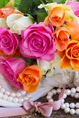 stock photo of mother-of-pearl  - pink and orange roses with lace and pearls - JPG