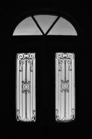 picture of motif  - Vintage door frame with decorative motif and arched glass lite - JPG