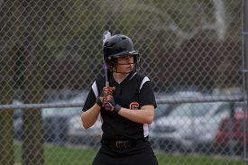 image of fastpitch  - A female fastpitch softball player sizing up the pitcher. ** Note: Soft Focus at 100%, best at smaller sizes - JPG