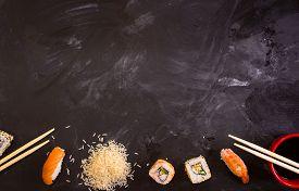 foto of soy sauce  - Overhead shot of sushi on dark background - JPG