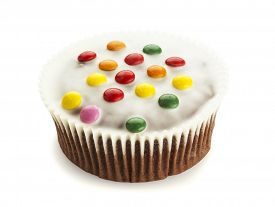 foto of icing  - Cupcake with white chocolate icing and smarties isolated on white background - JPG