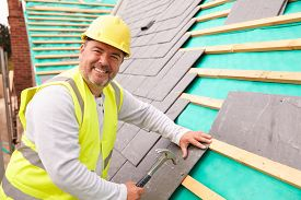 pic of slating  - Construction Worker On Building Site Laying Slate Tiles - JPG