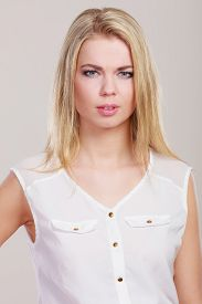 image of frown  - Woman frowning and looking askance - JPG