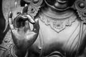 Detail Of Buddha Statue With Karana Mudra Hand Position poster