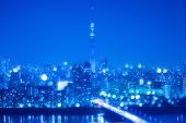 Tokyo City Night Background With Blur Bokeh Lights poster