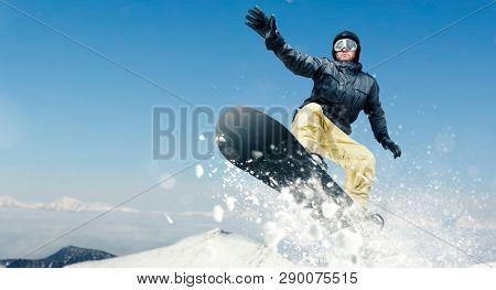 Male snowboarder dangerous downhill in