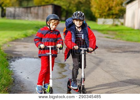 Two Little Kids Boys Riding