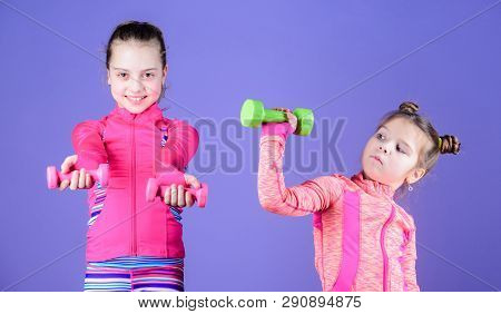 poster of Power And Energy. Little Children Developing Physical Fitness. Cute Sisters Doing Gym Fitness Exerci