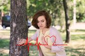 Mature Woman Suffering From Heart Attack Outdoors poster
