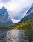The lake is surrounded by high mountains. Mountain Lake is a fabulous beauty in Bavaria. Konigssee - poster