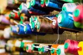 Close Up Of Colorful Sewing Threads In Drawer. Closeup Shot Of Multicolored Spools Of Thread, Sewing poster