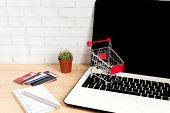 Small Red Shopping Cart Or Trolley On Laptop Keyboard, Technology Business Online Shopping Concept poster