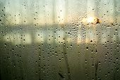 Raining Water Drops On A Wet Window Closeup Image. Condensed Moisture On A Glass Surface In The Morn poster