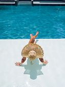 Woman relaxing in swimming pool at spa resort. relaxing concept. poster