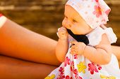 Childhood Happiness Concept. Little Baby Playing On Beach During Summertime, Mother Watching Kid. poster