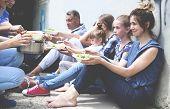 Volunteers Serving Food For Poor People Outdoors poster