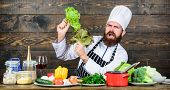 Healthy Nutrition. Healthy Food Recipe. Eat Healthy. Dieting Concept. Man Wear Hat And Apron Hold Le poster