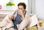 stock photo of high fever  - Sick Woman with Thermometer - JPG