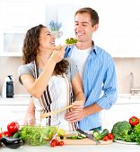 Cooking.Happy Couple Cooking Together - Man and Woman in their Kitchen at home Preparing Vegetable S
