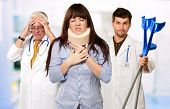 stock photo of neck brace  - Woman With Neck Brace In Front Of Doctors - JPG