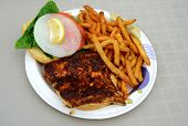 foto of mahi  - blackened mahi mahi fish sandiwch and a french fries on a plate - JPG