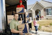 picture of moving van  - Family and worker unloading delivery van in front of a new house - JPG