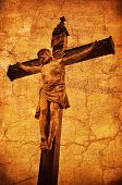 picture of crucifiction  - A statue of Jesus Christ crucified on a cross over a grunge background