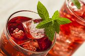 stock photo of hibiscus  - Cold Refreshing Berry Hibiscus Iced Tea with Mint - JPG