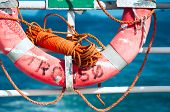 pic of tromso  - Lifebuoy on a ferry at sea background - JPG