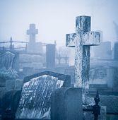 pic of headstones  - Cemetery in fog  - JPG