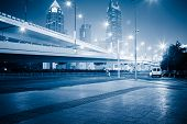 stock photo of transpiration  - overpass at night with skyscrape at shanghai china - JPG