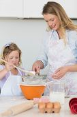 image of flour sifter  - Mother teaching daughter to make cookies at kitchen counter - JPG
