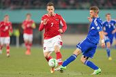 VIENNA,  AUSTRIA - MARCH 22 Marko Arnautovic (#7 Austria) and Rogvi Baldvinson (#5 Faroe Islands) fi