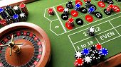 image of roulette table  - Casino complete table with roulette and chips - JPG