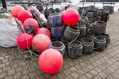 stock photo of dartmouth  - Lobster and Crab Pots and Fluorescent Red Buoys on Quayside