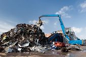 stock photo of scrap-iron  - working metal scrap loading machine - JPG