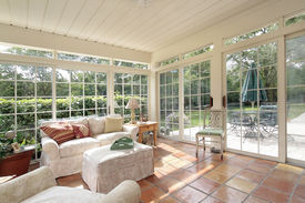 stock photo of screen-porch  - Porch in suburban home with spanish tile - JPG