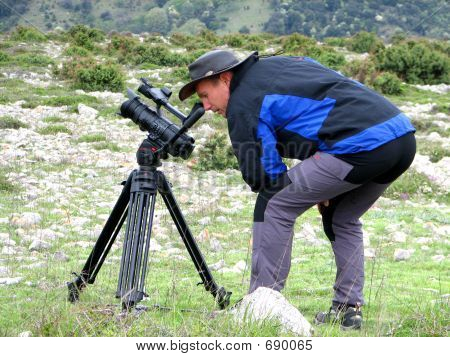Picture or Photo of Cameraman filming in nature