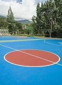 pic of netball  - colorful new Outdoor basketball court floor and blue sky - JPG