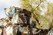 stock photo of junk-yard  - Large blocks of low grade steel at a metal recycle scrap yard - JPG