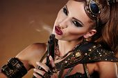 pic of steampunk  - Steampunk woman over gunge background - JPG
