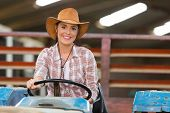 picture of barn house  - female farmer driving a tractor in farm house - JPG