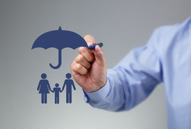 picture of family planning  - Businessman hand drawing an umbrella above a family concept for protection - JPG