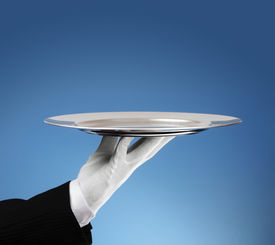 image of dinner invitation  - Waiter holding an empty silver platter ready for product placement - JPG