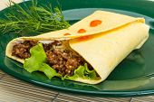 image of shawarma  - Shawarma with meat salad leaves and spices