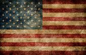 stock photo of american flags  - American flag on the stained grungy background - JPG